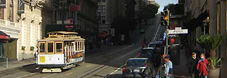 Early morning at Union Square as a cable car rolls down the hill.