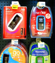 Inexpensive moble phones for sell in a supermarket