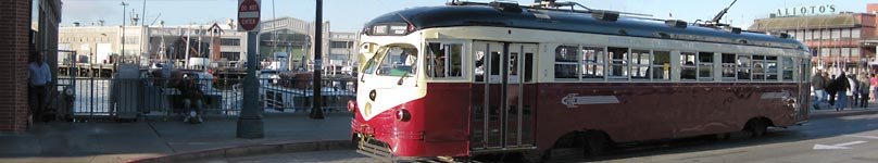 A vintage street car rolls throught San Francisco's Fisherman's Wharf
