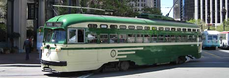 A vintage streetcar going down Market Street
